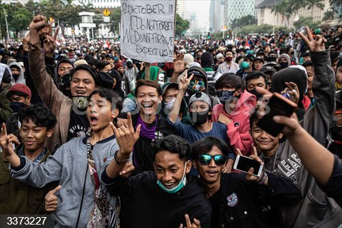13 October 2020, Indonesia, Jakarta: Students take part in a demonstration against a government omnibus bill on job creation which they believe will deprive workers of their rights. Photo: Donal Husni/ZUMA Wire/dpa