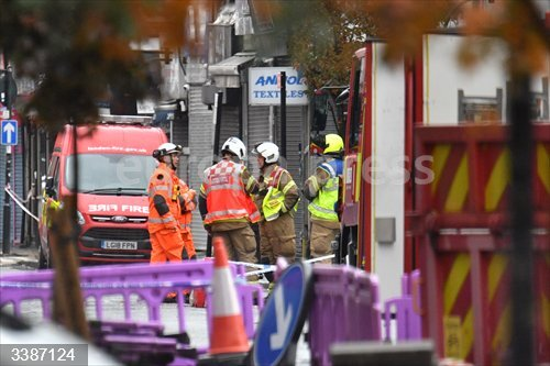 21 October 2020, England, Ealing: Emergency services inspect damage at the scene of a suspected gas explosion. Photo: Dominic Lipinski/PA Wire/dpa