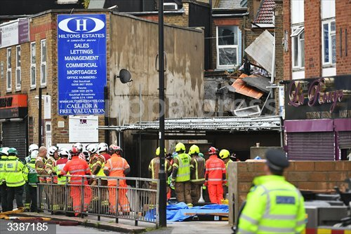 21 October 2020, England, London: Emergency services at the scene of a suspected gas explosion on King Street in Ealing, west London. Rescuers are involved in a